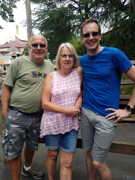 Zach with his mom and dad.