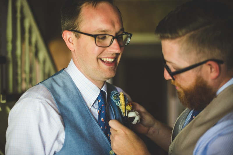 Tim puts on Zach's boutonnière.