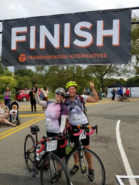 Finishing a 104 mile bike ride with my friend Sarah