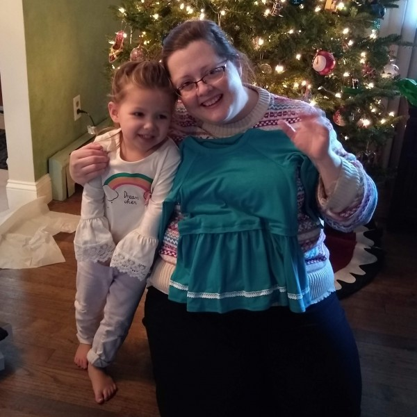 Amy with one of the little cousins she sews for