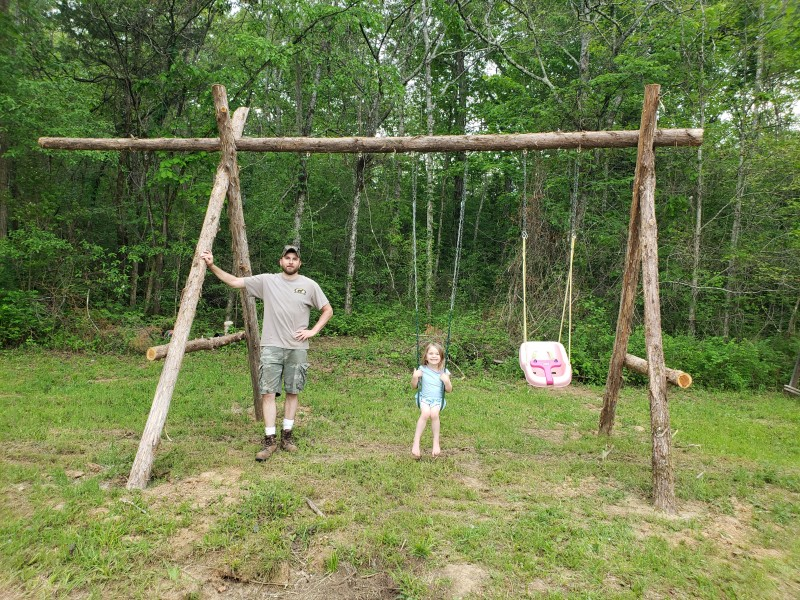 Jimmy made this swingset from trees in our yard.