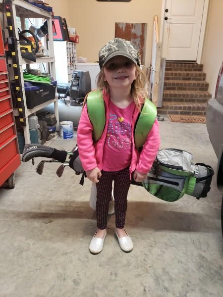 Got her first golf club set.