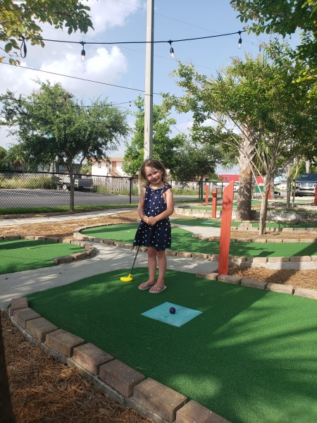 Julianne's first time playing mini golf