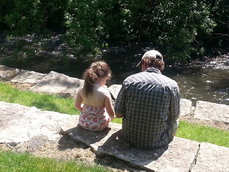 Daddy gigi sitting by the creek