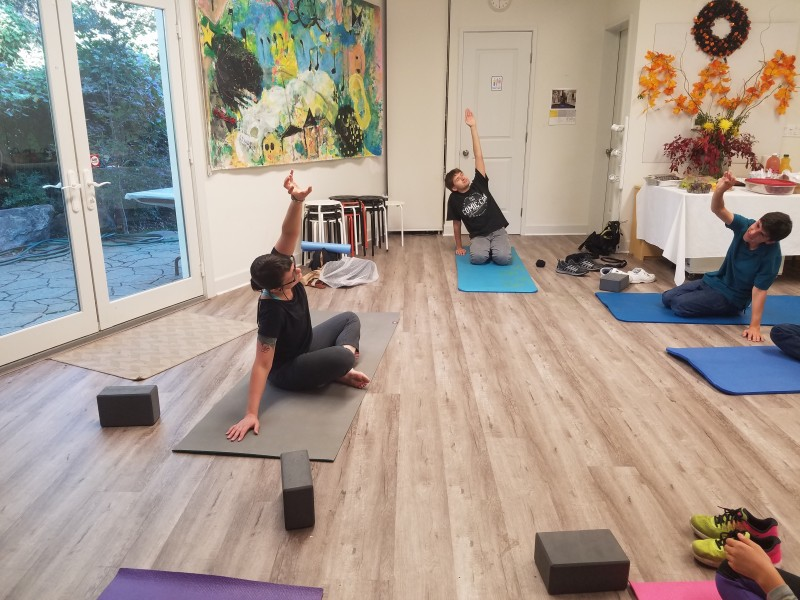 Teaching a special needs yoga class.