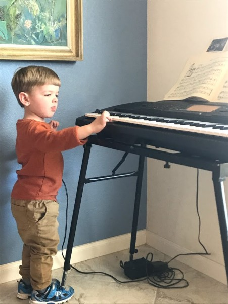 Maxwell playing grandparents keyboard