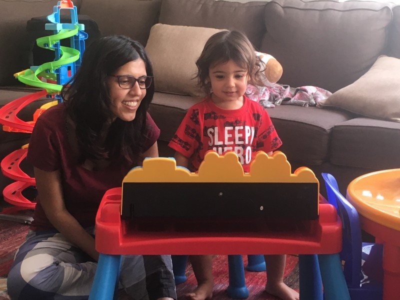 Checking out a new Christmas gift with Auntie Sapna