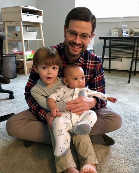 Kiernan loves to hold his cousin Caden