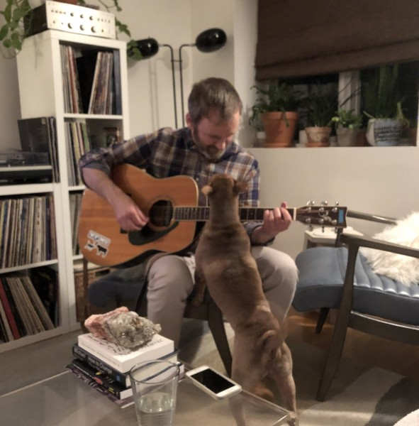 Tim playing music for Charlie.