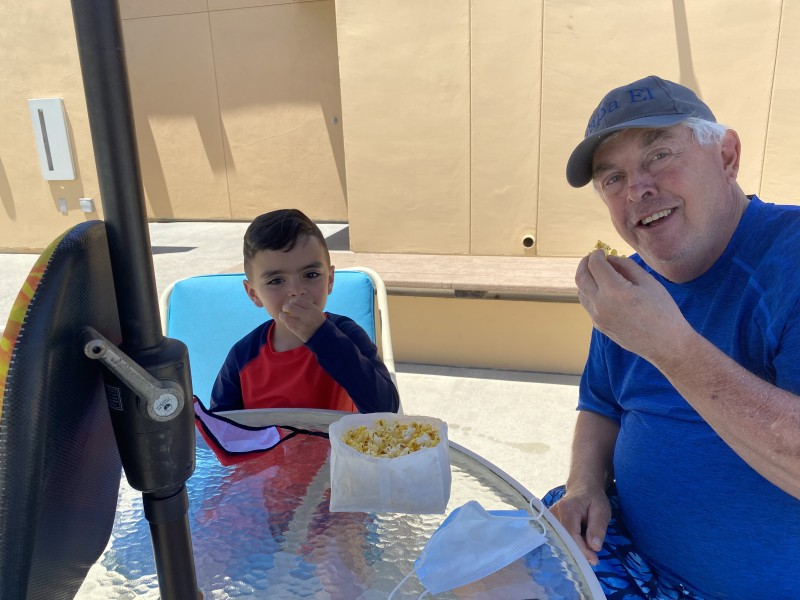Eating popcorn with Papa (Diana's dad) at the pool