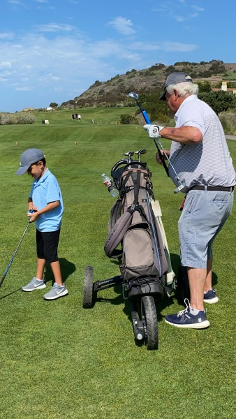 Playing golf with Papa (Diana's dad)