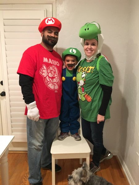 Mario, Luigi, and Yoshi getting ready for trick-or-treating