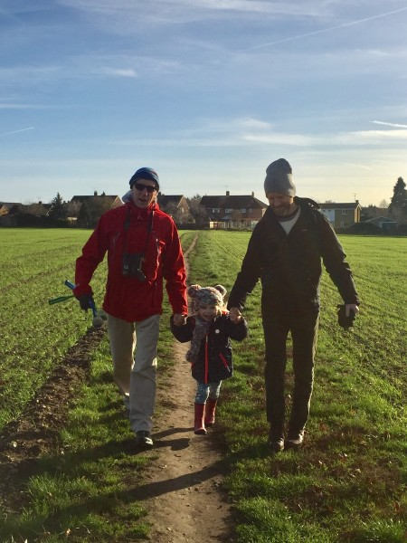 Tim, his dad Andy, and our niece, Isla taking a walk in the English countryside