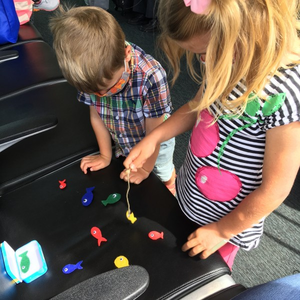 Playing with the little felt and magnetic fish game I made