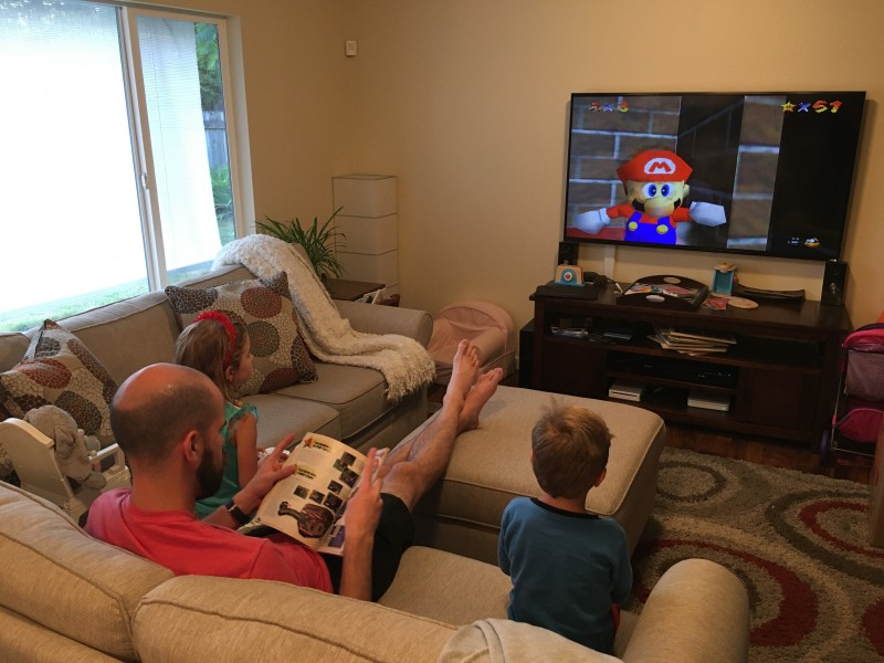 The kids love playing Super Mario 64 with daddy.