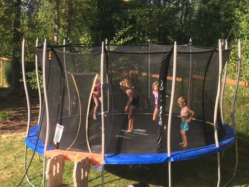 Sprinkler and trampoline fun. I loved doing this as a kid.