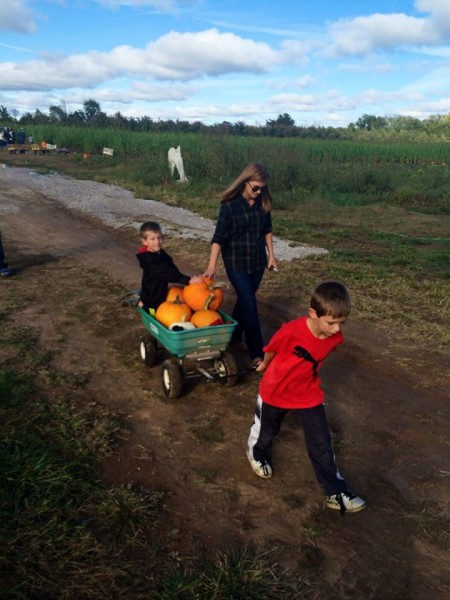 Pumpkin picking is another favorite family tradition that we all take very seriously! Biggest pumpkin gets to clean out everyone else's pumpkin guts!