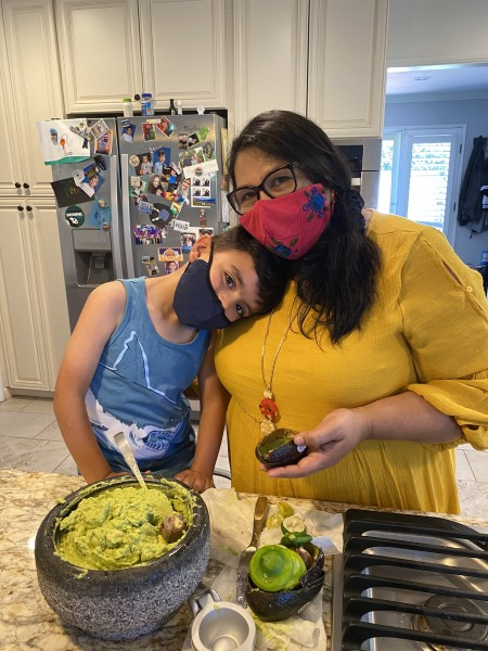 Nico and Grammy making guacamole