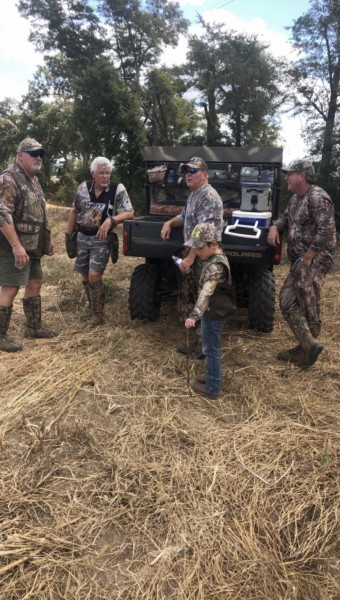 Kayden with his papa and great uncles getting ready to hunt