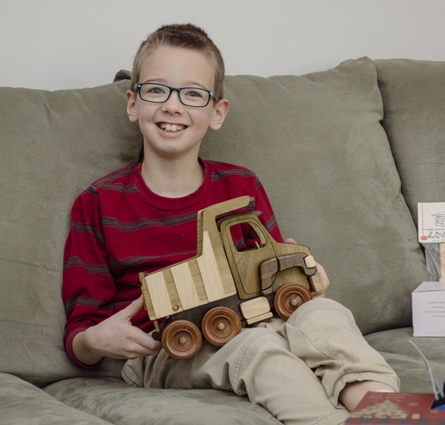 A few years later for Christmas he got a dump truck also made by his mom that works well with the front-end loader.