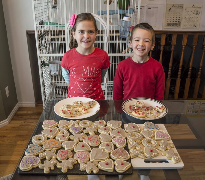 Every year we spend lots of time making Valentine cookies to share with friends & neighbors. Of course, Austin and Emma love decorating some of their own to eat too.