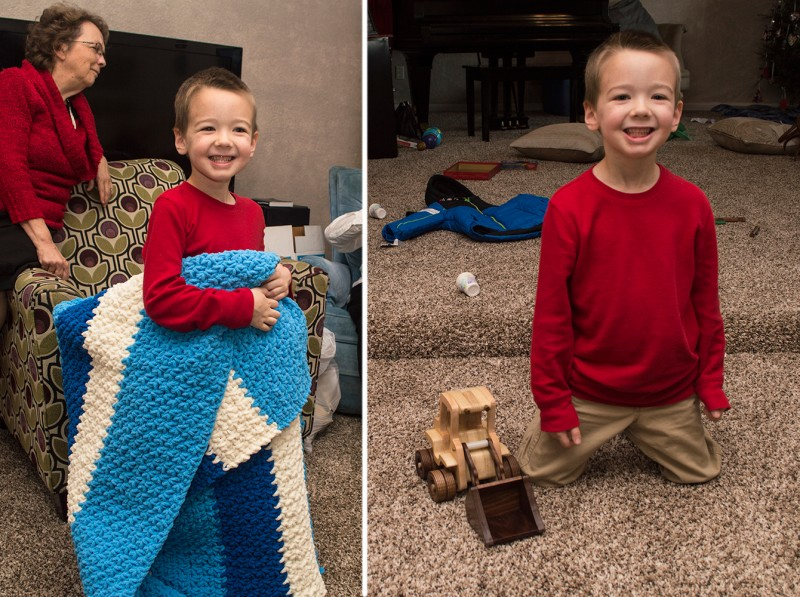 Austin with Christmas gifts his mom made: a blanket for his bed & a wooden front-end loader.