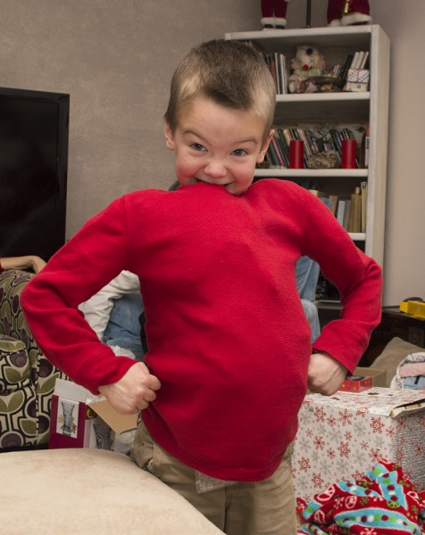 """Austin stuffed himself with the extra wrapping paper at Christmas so he could look """"strong."""""""