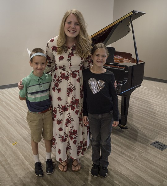 Here are Austin and Emma with their teacher after a fun recital where they were supposed to dress up somehow to fit their piano piece.