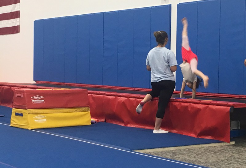Emma loves to hang, swing, spin, flip, and bounce, and her gymnastics class gives her a great outlet to get better at all these things.