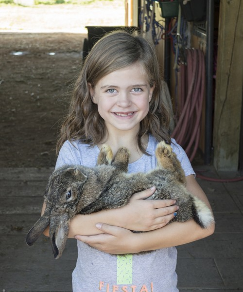 Emma has a particular love for animals. Holding a soft bunny definitely gives her a reason to smile!
