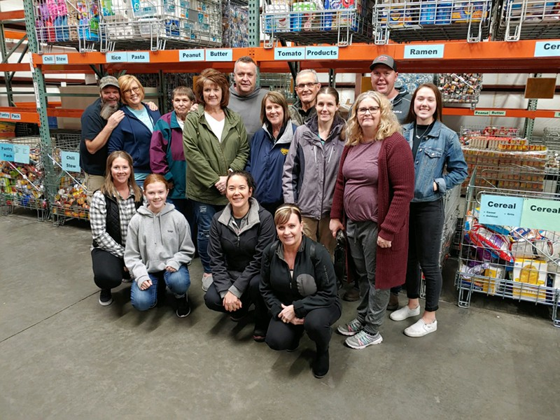 Time to serve! Here is Rebecca with a group that went ot help sort food at a local food pantry.