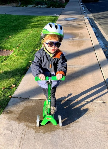 This is C.  He is almost two and he is as determined as they come.  He loves to do whatever L is doing--clearly, since by the time he turned 19 months he could already scooter on his own.  He is very go-with-the-flow and has a sweet, cuddly side to h