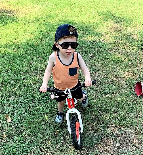 C loves to spend all his time on his balance bike and is on track to ride a pedal bike while he's 2 as well.
