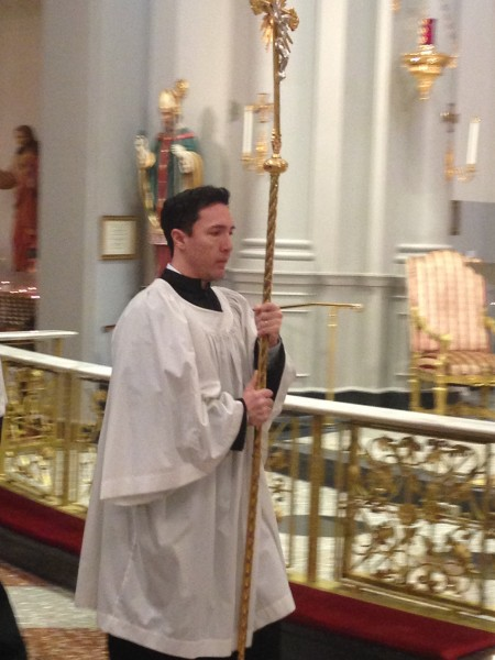Hugo serves in the traditional latin mass on Sundays