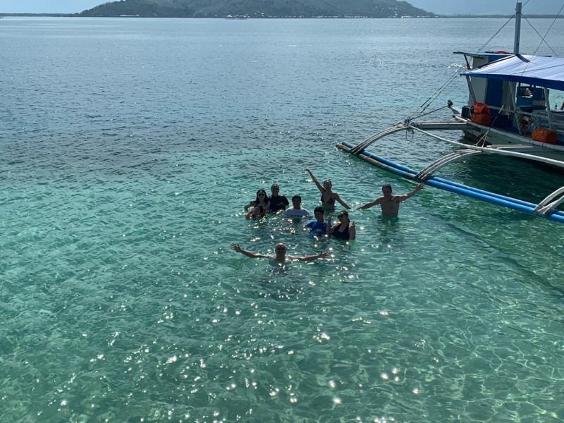 The Philippines is known for its pristine islands and clear waters. This is us with some of the family in clear waters