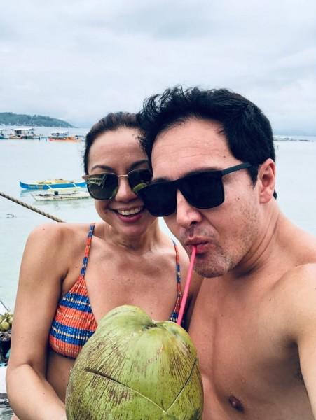 Enjoying fresh coconut by the sea