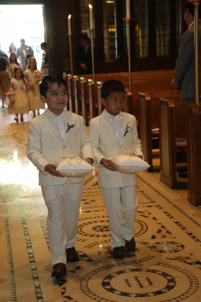 We opted to have our wedding party consist of our nephews and nieces to honor our love for children and our close relationships with them. Here are Pam's nephews serving as ring bearers