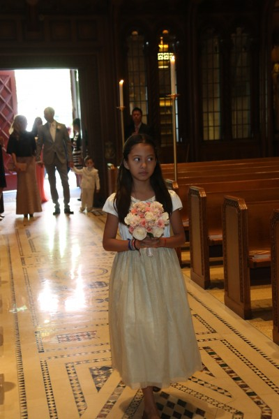 One of Pam's nieces and her godchild who is very especially close to Pam so she got to walk down the aisle by herself