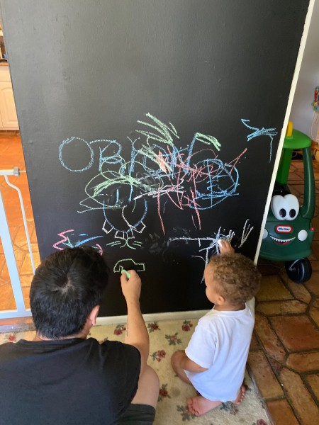 Drawing on the chalk wall!