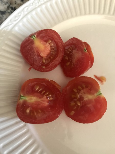 Every summer we love planting tomatoes and green peppers in our backyard