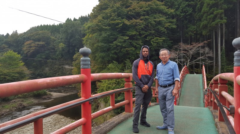 Crossing the bridge to the Temple of Success with Ayano's Dad