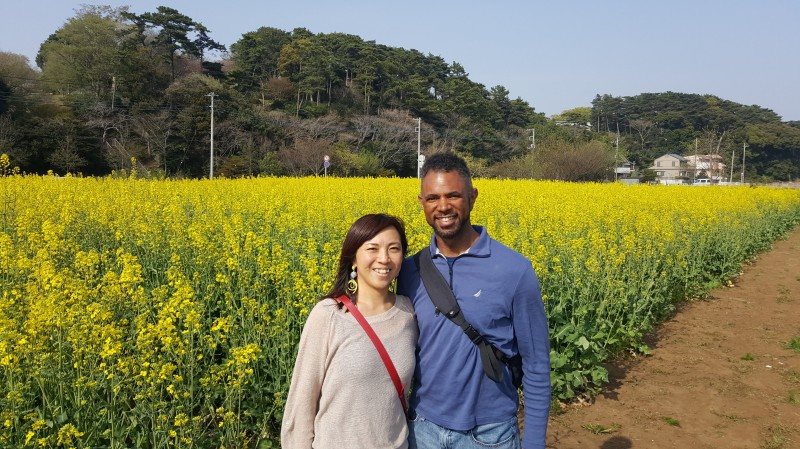 RAyano in front of flower field