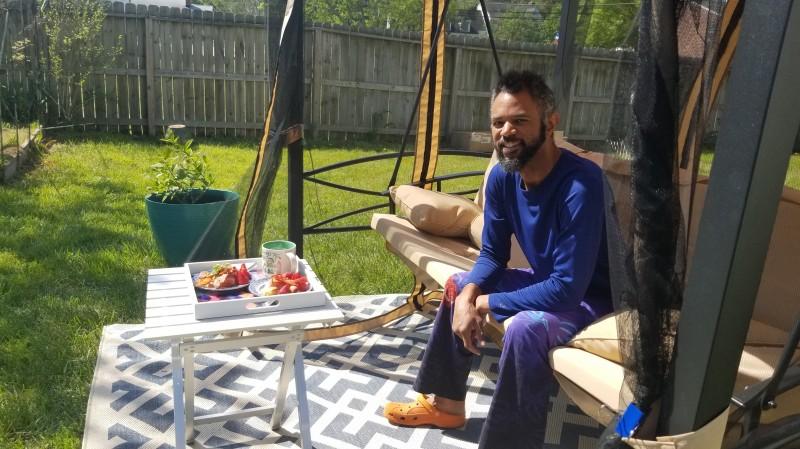 Ra eating breakfast in backyard