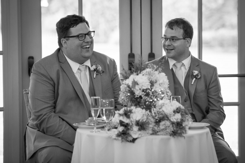 Laughing at our wedding toasts