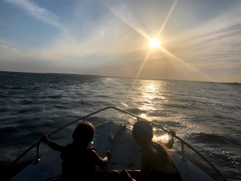 We're so lucky to get to spend so much time on the water. Here we are with our nieces on a late summer day.