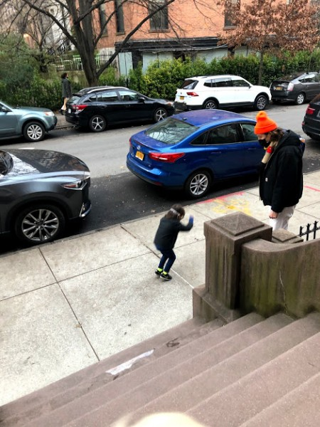The best thing about growing up in Brooklyn is that the whole city is your playground! Here is David in a sidewalk jumping competition with a little friend.