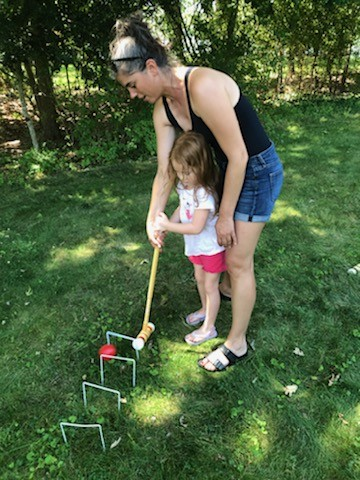 Teaching our niece to play croquet in the front yard!