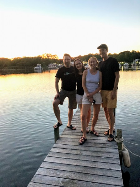 David is from a large family and they're all very close. Here he is with siblings on our dock.