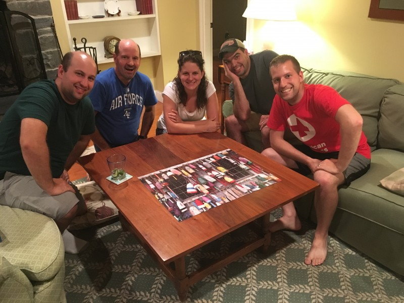 Nathan's siblings & dad after laboring over a puzzle until midnight!