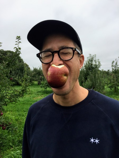 Sampling the fruit during our annual apple picking family trip.